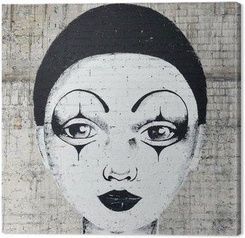 Białej twarzy clown graffiti na brickwall