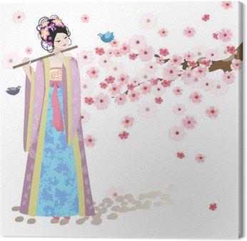 Piękna dziewczyna w pobliżu Oriental kwiatów wiśni